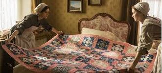 Quilts are like flags on a bed